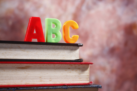 close up of the alphabet abc in front of the book