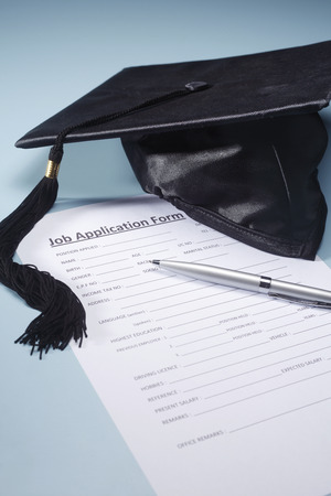 Graduation hat with application form. Stock Photo