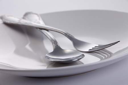 Fork and spoon on the plate.