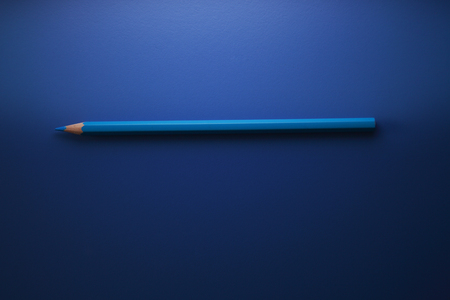 blue color pencil on the blue background