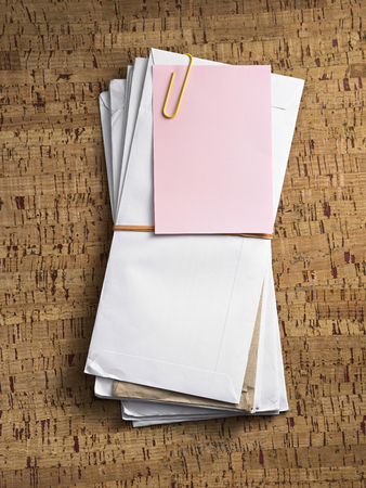 stock image of stack of letter with blank note