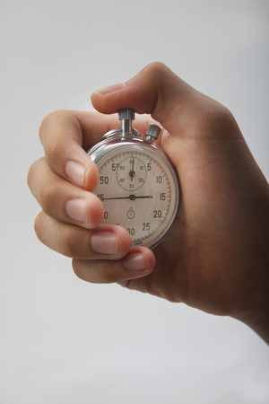 hand holding a stop watch