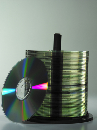 stack of the cd on the plain background