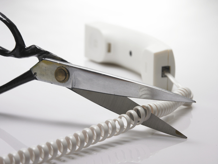 cutting away the cord of the phone