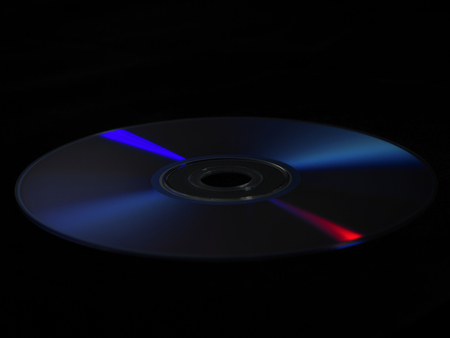 close up of compact disc on black background Stock Photo