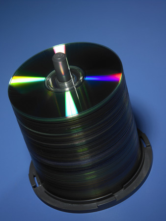 stack of blank cd on the blue background Stock Photo