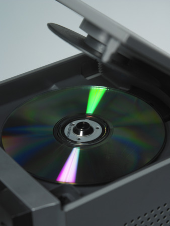 cd in cd player on the plain background Stock Photo