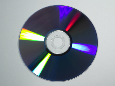close up of compact disc on plain background Stock Photo