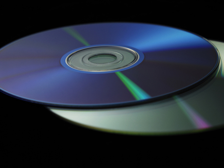 close up of compact disc on dark background Stock Photo