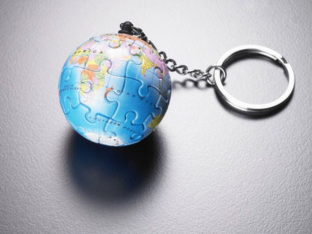 Jigsaw puzzle sphere on keychain. Stock Photo