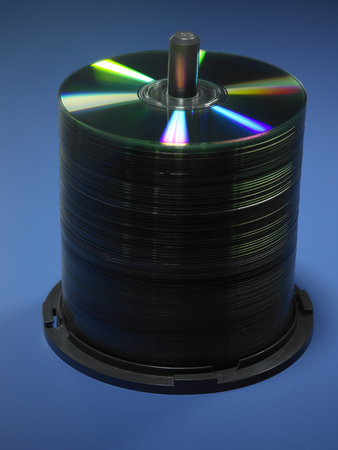 stack of cd or dvd on the blue background