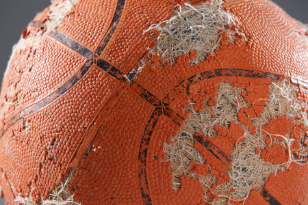 worn-out basketball ready to been thrown away Stock Photo