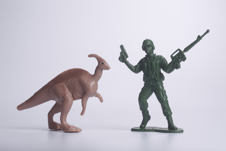 close up of the toy army and dinosaur