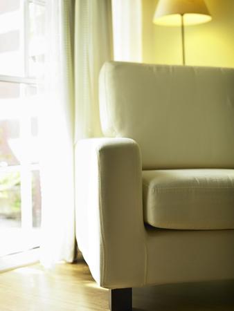 Comfort beige textile sofa in living room 写真素材