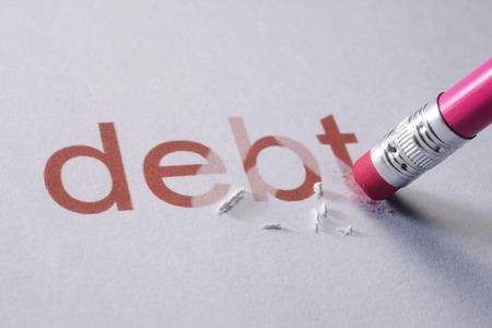 crayon effaçant le mot-dette