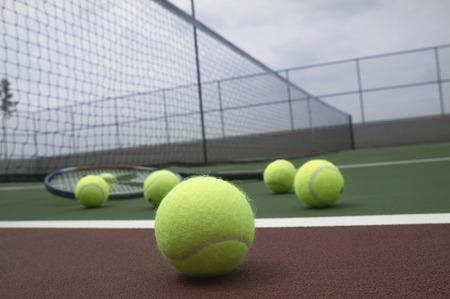 tennis ball near the base line