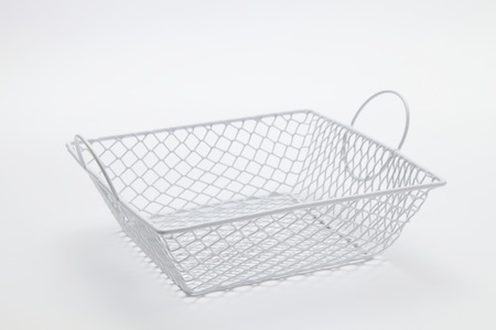 stock image of the wire basket for kitchen Imagens