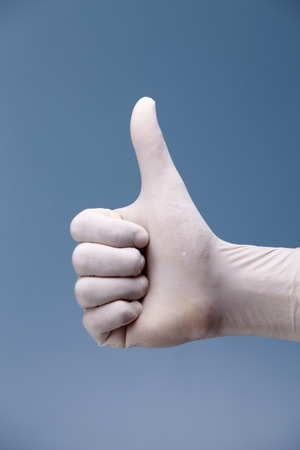 Hand shows the gesture on a coloured background.
