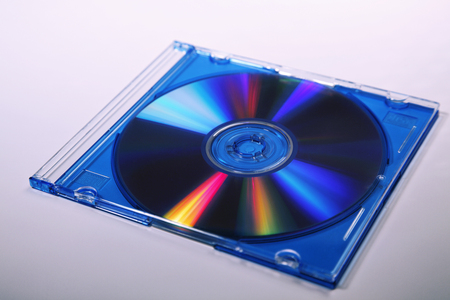 Computer or music cd with green cd case and blank label