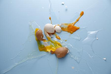Egg yolk and egg white splattered.