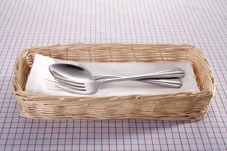 Fork and spoon in a rattan basket. Reklamní fotografie