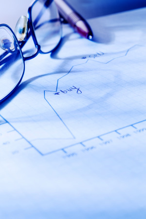 Graph with pen and glasses. 스톡 콘텐츠