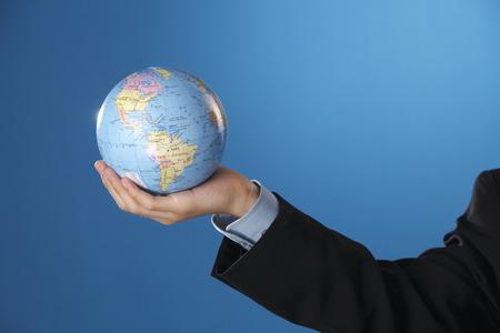 Human hand holding a globe. Stock Photo