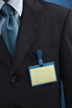 Person with name tag on chest. Stock Photo