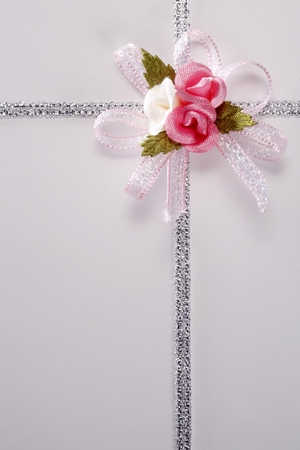 Present box with ribbon on the background.