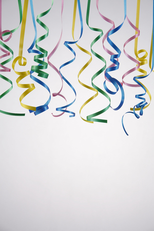 Curled ribbons isolated on the background. Stock Photo