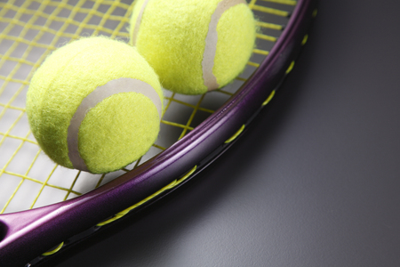 Two tennis balls and a racquet. 版權商用圖片
