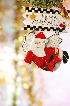 cute Santa figure  hung on a christmas tree.