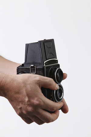 stock image of the unrecognisable people holding a antique camera Stock Photo