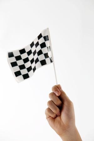 hand holding a mini checker flag