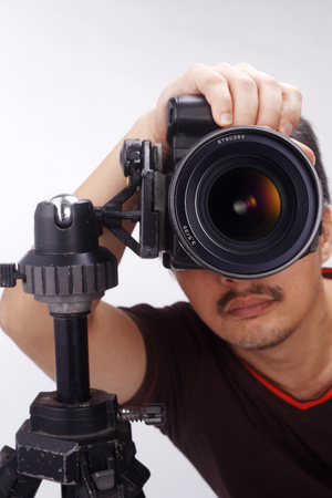 stock image of the photographer focusing and taking picture Stock Photo