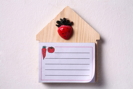 blank note on house shaped board