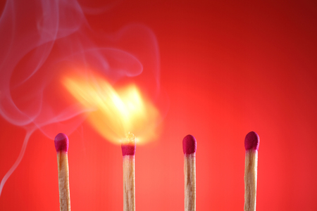 burning matches on the red background