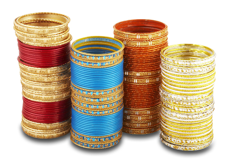 Four stacks of colorful bangles