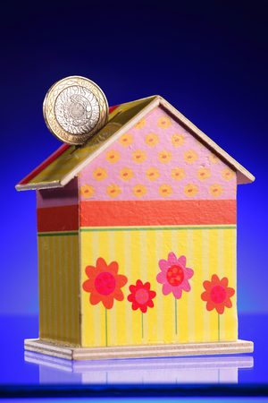 coin bank in the shape of a house
