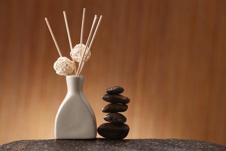Sticks of incense in ceramic jar