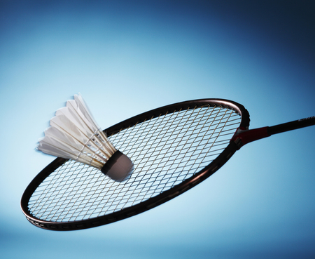 Badminton raquet striking shuttlecock Stock Photo