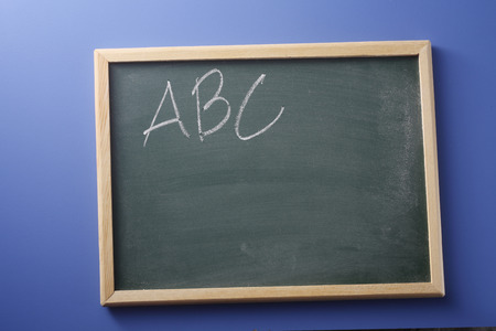 ABC printed in chalk on blackboard 写真素材