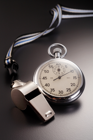 Close up of whistle and stopwatch