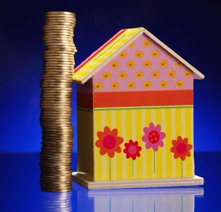 stack of the gold coins beside of the play house