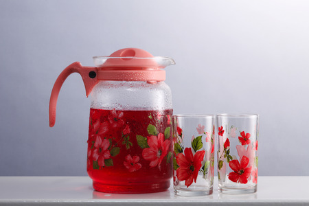 cold rose syrup drink in the water pitcher 写真素材