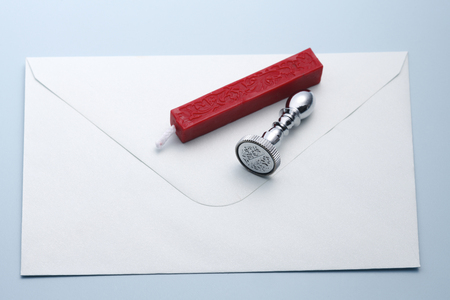 Wax seal, stamp and quill on the white envelope