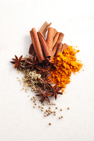 group of spices ,turmeric,cinnamon,pepper and anise star Banco de Imagens