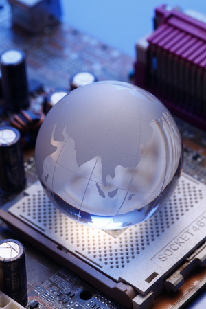glass globe on the computer mother board Stock Photo