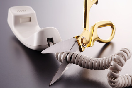 Phone cord being cut by scissors Banco de Imagens