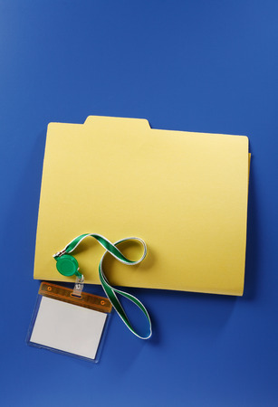 Empty name badge and file document Stockfoto